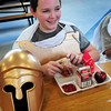 Amesbury: Even Spartans get a good lunch at Amesbury Middle School, taking time out from their annual Greek Festival yesterday. Tyler Rybicki, 11, only took his mask off to eat before going back for the different activities scheduled all day longfor the sixth-graders who have been learning about Ancient Greece. Bryan Eaton/Staff Photo
