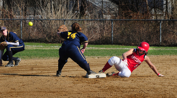 Amesbury: Amesbury's Ashley Valme makes it safely to second base on a hit by Alexis Bodwell. Bryan Eaton/Staff Photo
