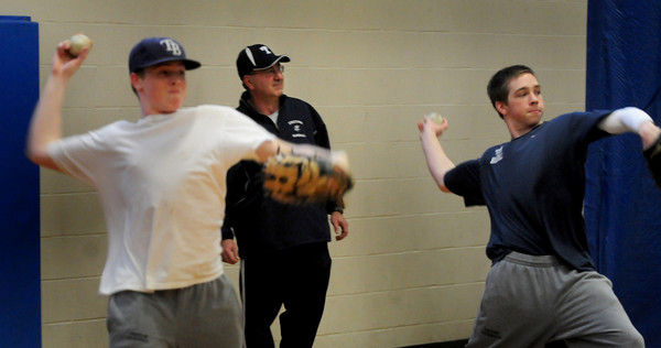 Byfield: New Triton varsity baseball coach Richard Dube watches his team practice. Bryan Eaton/Staff Photo