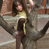 Newburyport: Eliza Naftoly, 4, of Georgetown climbs a tree at the Tot Lot on Inn Street in Newburyport on Monday afternoon. The Newburyport Montessori School student went to enjoy the weather after getting out for the day. Bryan Eaton/Staff Photo