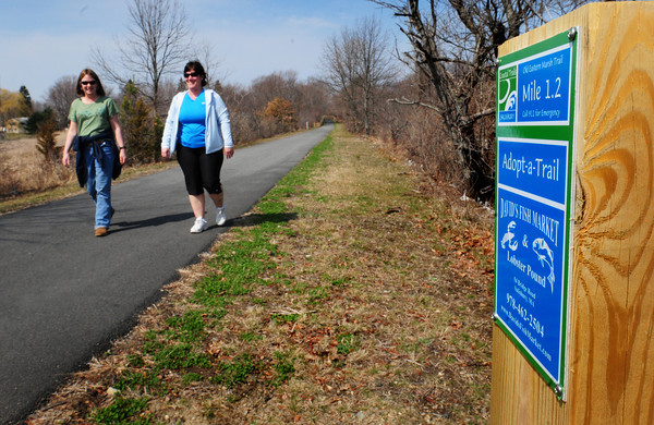 Salisbury: Jennifer Gray, left, of Salisbury and Ellen Bissaillon of Merrimac walk along past mile marker 1.2 on the Old Eastern Marsh Trail in Salisbury just south of Mudnock Road. Local businesses have sponsored the Adopt-a Trail Markers for every 1/10th of a mile. Bryan Eaton/Staff Photo