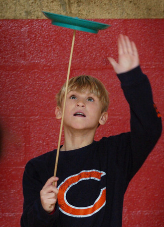 Newburyport: Griffin Coir, 9 concentrates on balancing a spinning plate in gym class at the Bresnahan School on Wednesday morning. The children were at different stations learning balance, eye to hand coordination and other skills. Bryan Eaton/Staff Photo