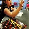Amesbury: Ava Harlow, 8, likes the  flavor of a fruit-flavored chocolate. Bryan Eaton/Staff Photo