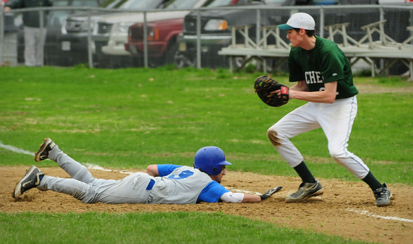 West Newbury: Georgetown's Chris Petro just makes it back to first on a steal attempt past Pentucket first baseman Turner Newton. Bryan Eaton/Staff Photo