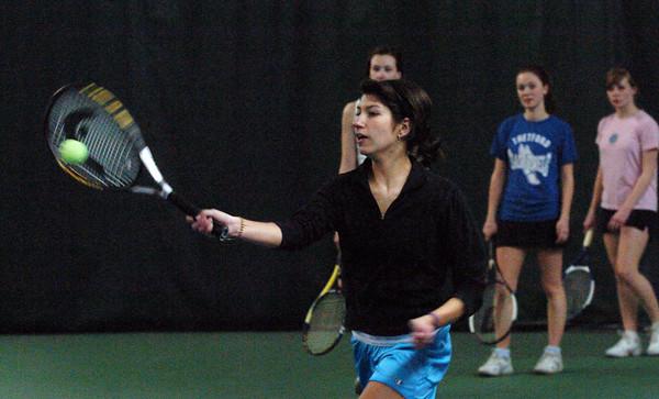 Newburyport: Newburyport High's Carlina Arango and the rest of her tennis team practice indoors at the Newburyport Racquet Club. Bryan Eaton/Staff Photo