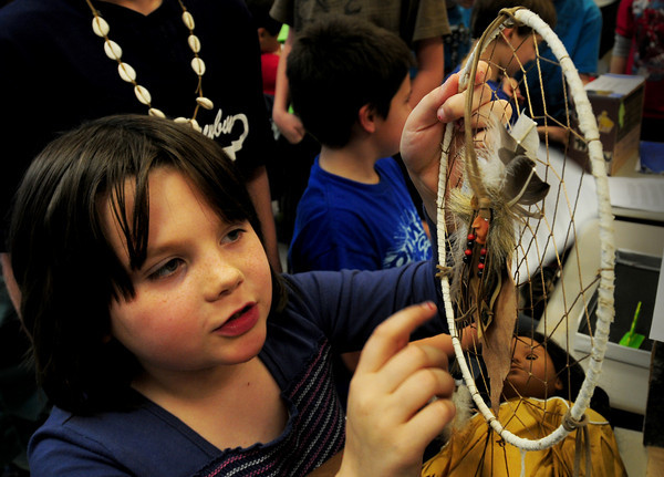 """Newbury: Arianna Stevens, 8, shows off a dream catcher in Pam WInters' class at Newbury Elementary School on Tuesday afternoon. Students read a non-fiction book and then wrote a four paragraph report on the book and created a diorama to show to fellow classmates. Arianna chose the book """"Meet Kaya"""" about an American Indian girl. Bryan Eaton/Staff Photo"""