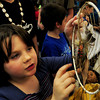 "Newbury: Arianna Stevens, 8, shows off a dream catcher in Pam WInters' class at Newbury Elementary School on Tuesday afternoon. Students read a non-fiction book and then wrote a four paragraph report on the book and created a diorama to show to fellow classmates. Arianna chose the book ""Meet Kaya"" about an American Indian girl. Bryan Eaton/Staff Photo"