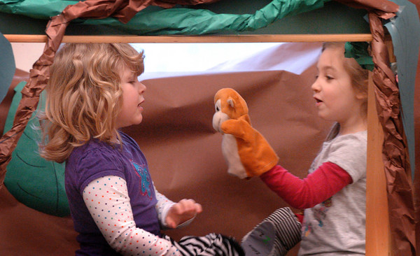 Salisbury: Lexi Novakowski, left, and Julia Salvati, both 4, put on a puppet show of animals from the Rain Forest which they're learning about. The two were in Julie Deschene's preschool class at Salisbury Elementary School. Bryan Eaton/Staff Photo