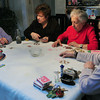 Seabrook: Playing a type of poker, friends, from left, Addie Caruso, Pearl Travis, Annie Bonacorsi and Sally Lahane look at their cards. Bryan Eaton/Staff Photo