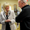 Newbury: New town administrator for Newbury, Tracy Blais, talks with board of assessors member Peter Murphy at a meet-and-greet at Newbury Town Hall on Wednesday morning. Bryan Eaton/Staff Photo