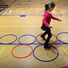 Rowley: Anika Siminoff, 8, moves through hoops at the Pine Grove School on Tuesday morning. She and fellow second-graders were participating in an obstacle course in Dan Vadala's gym class. Bryan Eaton/Staff Photo