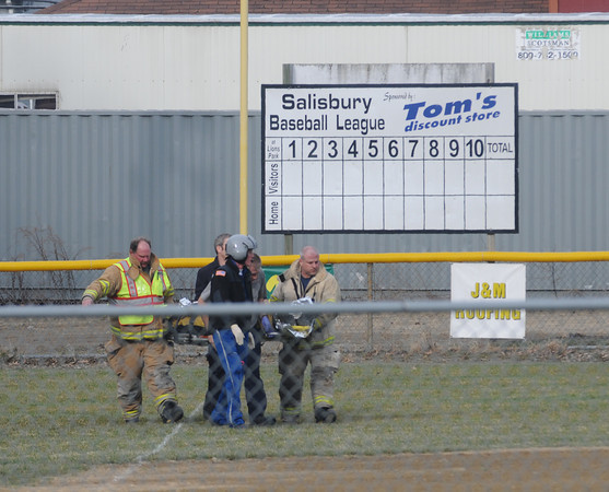 salisbury: EMTs carry a man who was injured in a ax attack on Salisbury Point Ghost Trail near Lion's Park, to a medvac copter waiting on the Salisbury Little League field.  Jim Vaiknoras/Staff photo