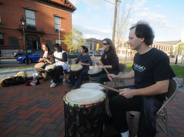 "Newburyport: The drum group Mamadou Diop performs at the Tsnad Against Racism Rally at Brown Square in Newburyport Friday night. The event sponsored by the YWCA and the Newburyport Commission for Diversity and Tolerance included speaches , dancing and participants taking the ""Pledge against Racism"". Jim Vaiknoras/Staff photo"