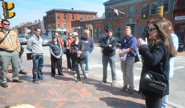 Newburyport: Sarah White talks to visitors from the APA 2011 Nation Conference on the corner of State and Pleasent Streets in Newburyport Sunday. Jim Vaiknoras/Staff photo