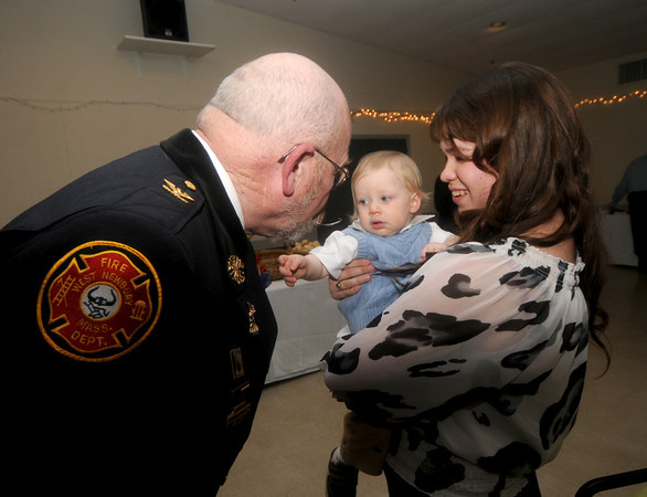 "Newburyport:  Fire Chief Raymond ""Rock"" Dower says hi to his grandson Liam Fletcher as he is being held by his daughter Kaitlin Dower at his retirement party at the Elks in Newburyport Friday night. Jim Vaiknoras/Staff photo"