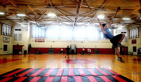 Amesbury: Amesbury high student Garrett King uses a rope drill to practice the pole vault during track practice Friday afternoon at the amesbury high gym. Practice was held indoors due to the snow. Jim Vaiknoras/Staff photo