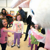 Salisbury: Kaycee Currier, 4, reaches out to shake hands with the Easter Bunny at the Annual Egg Hunt at the Salisbury Elementary School Saturday. The event , sponsored by the Parks Dept. featured music face painting, and Violet the Clown along with the egg hunt and the Easter Bunny. Jim Vaiknoras/Staff photo
