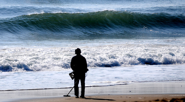 Salisbury: Bernie Meadows hunts for metal Sunday morning kicked up by the resent storms along Salisbury Beach