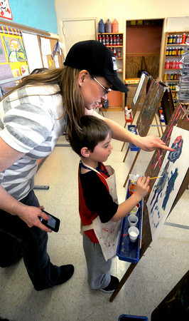 Newburyport: Art teacher Melissa Squires works with kindergatener  Cameron Caponigro as they experiment with coors at the Brown School in Newburyport Friday. Jim Vaiknoras/Staff photo