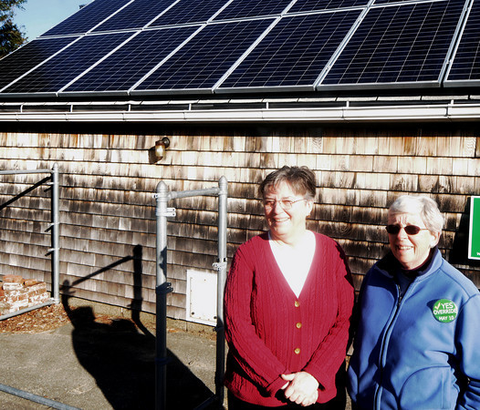 Newbury:  LuAnn Kuder,right, and Maureen O'Brien,  have solar panels on their Newbury home. Jim Vaiknoras/Staff photo