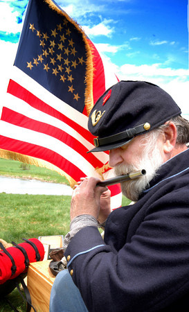 """Amesbury: <br /> Ellsworth Brown of the 3rd Maine plays the fife at the """" Raise the Arm!"""" Civil War Encampment at Woodsom Farm. The event was a fund raiserto repair the 11th Massachusetts infantry monument at Gettysburg which was vandalised last winter.<br /> Photo by Jim Vaiknoras/Newburyport Daily News. Sunday, May 21, 2006"""