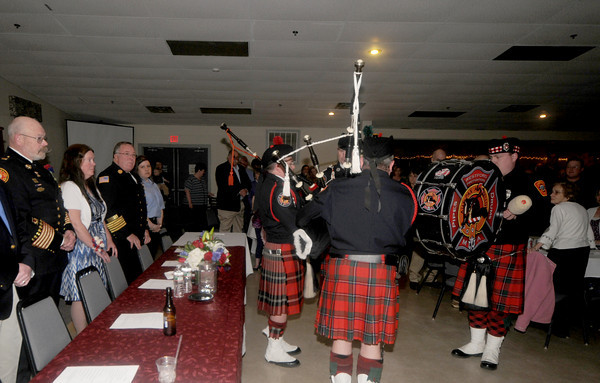 """Newburyport:  Fire Chief Raymond """"Rock"""" Dower slooks on as members of the Westboro fire dept play at his retirement party at the Elks in Newburyport Friday night. Jim Vaiknoras/Staff photo"""