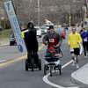 "Ipswich: Charles Trainer of Artistic Licence paces runners along Rt 1a at the annual ""chase the gorilla down Argilla""  5K road race on a Segway Saturday  morning at the YMCA in Ipswich. Jim Vaiknoras/Staff photo"
