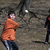 Amesbury: Troy Pender, 11, keeps his eye on the ball while playing baseball with his dad in Amesbuy Park Sunday. His brother Jared, 8, is catching. Jim Vaiknoras/Staff photo