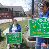 Newbury: Norman Rehn and Marlene Schroeder hold signs in favor of teh up coming override vote  Sunday at the Newbury Town Library as it  commemorated 10 years in its new building and 85 years serving the community. Jim Vaiknoras/staff photo