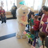 salisbury:The Easter Bunny greets kids at the Annual Egg Hunt at the Salisbury Elementary School  Saturday. The event , sponsored by the Parks Dept. featured music face painting, and Violet the Clown along with the egg hunt and the Easter Bunny. Jim Vaiknoras/Staff photo