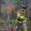 Newburyport: Firefighters knock down a brush fire along the Merrimack river off Merrimac Street in newburyport Friday. Jim Vaiknoras/Staff photo