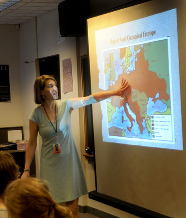 Amesbury: Amesbury Middle School teacher Anne Richardson points slide of Nazi occupied Europe during a presentation at the school. Richardson is a Holocaust Legacy Partner and is telling the story of survivor Netty Vaderpol. Jim Vaiknoras/Staff photo