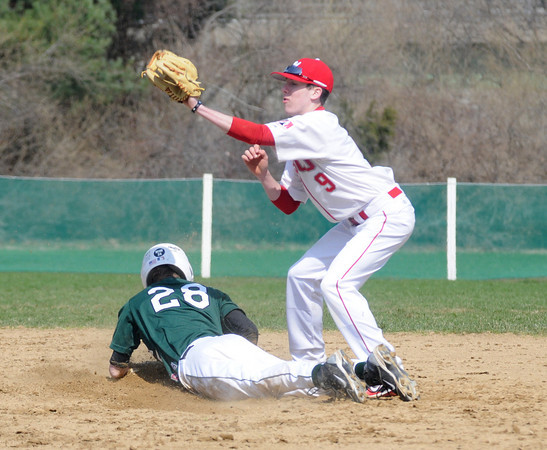 Boxford: Masco's Cory Tudor waits for the throw as Pentucket's  Josh Silva steals 2nd during their game  Saturday at Marsco. Jim Vaiknoras/Staff photo