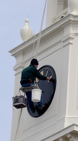 Newburyport: A seeplejack adds Roman numerals to the face of the clock on the steeple of St Paul's Church on High Street in Newburyport Monday afternoon.Jim Vaiknoras/Staff photo