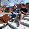 newburyport: Newburyport high students Jordan Dunn-Pilz, on guitar and Clayton Vye on the bongo talk advantange of a warm spring day Sunday to perform on Inn Street in Newburyport. Jim Vaiknoras/Staff photo