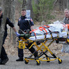 salisbury: EMTs wheel a man, who was injured in a ax attack, out of Salisbury Point Ghost Trail near Lion's Park. Jim Vaiknoras/Staff photo