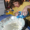 Newburyport: Second grader Emma Keith mixes up oobleck at The Annual Science Fair Thursday night at the Bresnahan School in Newburyport. Oobleck is a mixure of corn starch and water, has the consistancy of slim , and has properties of both a liquid and a solid. Emma was one of over 200 2nd and 3rd graders in the fair. Jim Vaiknoras/Staff photo