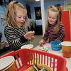 Amesbury: Taylor Robinson, 3, and Linsdey Williamson, 4, decorate cups during Preschool Storytime at the Amesbury Library Thursday. The program runs on Thursday's through the 14th and them picks up again May 5th, with PreSchool Movie Hour. Jim Vaiknoras/Staff photo