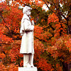 Rowley: <br /> The Civil War Memorial on Rowley Common stands silent in front of a maple tree who's leaves have turned red.<br /> Photo by Jim Vaiknoras/Newburyport Daily News. Monday, October 11, 2004