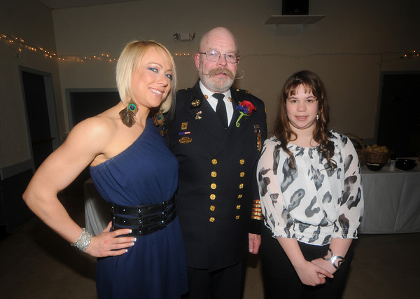 "Newburyport:  Fire Chief Raymond ""Rock"" Dower poses with his daughters, Mindi and Kaitlin  at his retirement party at the Elks in Newburyport Friday night. Jim Vaiknoras/Staff photo"