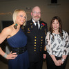 """Newburyport:  Fire Chief Raymond """"Rock"""" Dower poses with his daughters, Mindi and Kaitlin  at his retirement party at the Elks in Newburyport Friday night. Jim Vaiknoras/Staff photo"""