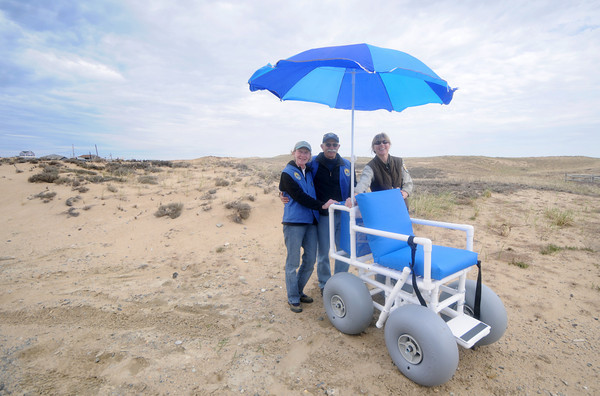 Newbury: Friends of the Parker River National Wildlife Refuge Deb and John Fichera and refuge employee Jean Adams stand with a brand new beach wheelchair purchased with donation. The chair is a replacement for one that was destroyed by vandals last year. Jim Vaiknoras/Staff photo