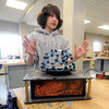 Byfield: Triton 7th grader Leo Hefernan checks his science fair project, a dome house, on an eathquake simulator atthe school Friday. Jim Vaiknoras/Staff photo