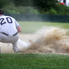 Rowley: Rowley's Jordan Silva disappears in a cloud of dust after diving back to first base during Monday afternoon's game against Hamilton. Photo by Ben Laing/Staff Photo