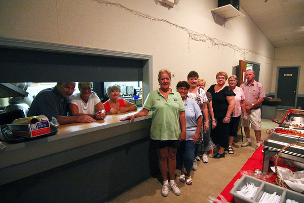 Newburyport: Volunteers at the Elks Club in Newburyport serve patrons their annual Yankee Homecoming Spaghetti Dinner Monday evening. Photo by Ben Laing/Staff Photo