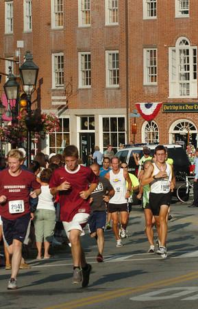 Newburyport: Runners in the Yankee Homecoming 5K Race head through Newburyport's Market Square. Bryan Eaton/Staff Photo