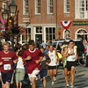 Newburyport: Runners in the Yankee Homecoming 5K Race head through Newburyport's Market Square. Bryan Eaton/Staff Photo