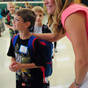 Merrimac: Camden Barber, 6, has a family photo taken with his first grade teacher Kate Byrne at the Sweetsir School in Merrimac on Wednesday. It was the first day of classes in the Pentucket Regional School District. Bryan Eaton/Staff Photo