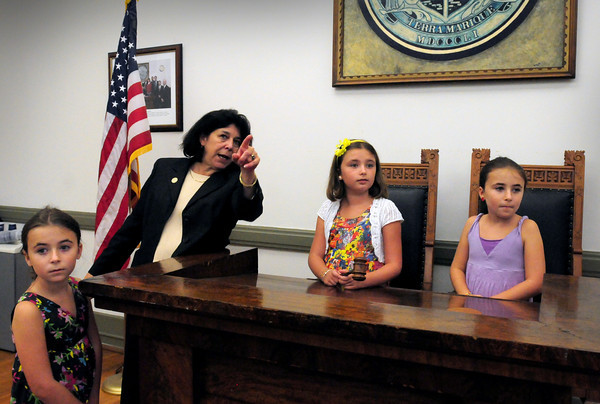 Newburyport: Newburyport Mayor Donna Holaday points to a picture of Newburyport's first mayor, Caleb Cushing to triplets, from left, Hanna, Kiara and Lena Ashe, 9, during a tour of city hall. The girls won auction to have lunch with the city's chief executive. Bryan Eaton/Staff Photo