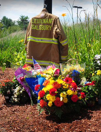 Salisbury: A memorial for Salisbury Fire Lt. Tim Oliveira, who will be laid to rest today, is set up in front of the station. Bryan Eaton/Staff Photo